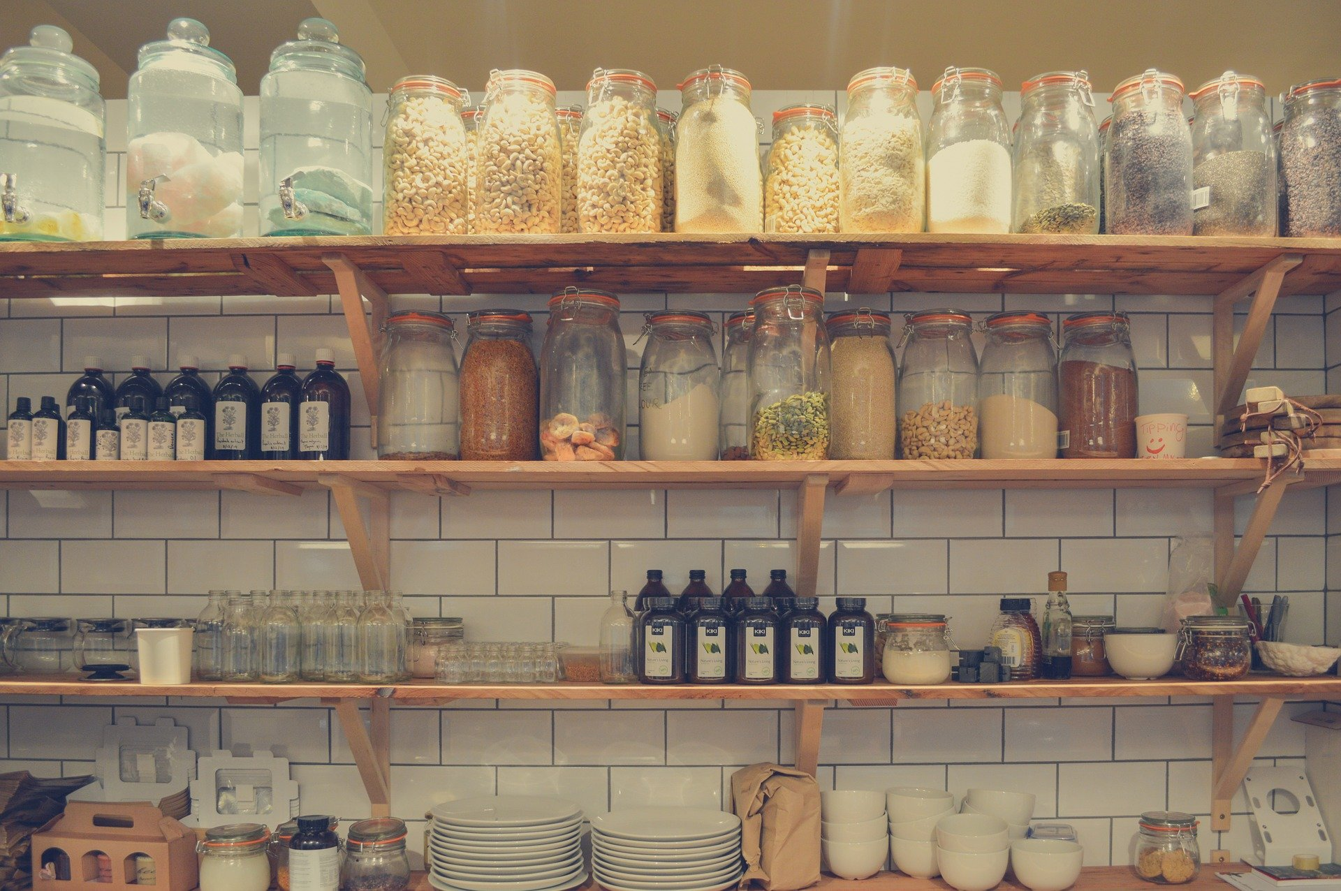 Pantry shelf with jars containing foods